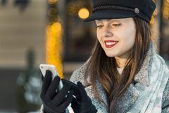 Girl Holding Phone royalty free stock photography