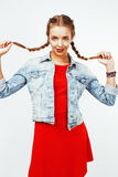 Young pretty stylish hipster blond girl with pigtails posing emotional isolated on white background happy smiling cool Stock Photography