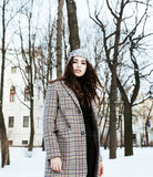 Young pretty stylish modern hipster girl outside on street, fash Stock Images