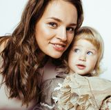 Young pretty stylish mother with little cute blond daughter hugg Royalty Free Stock Images