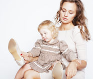 Young pretty stylish mother with little cute blond daughter hugging, happy smiling family, lifestyle people concept. Young pretty stylish mother with little cute Royalty Free Stock Photography