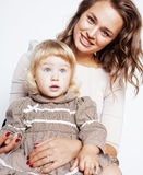 Young pretty stylish mother with little cute blond daughter hugging, happy smiling real family, lifestyle people concept. Close up Stock Photos