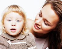 Young pretty stylish mother with little cute daughter hugging, h. Appy smiling family, lifestyle people concept close up Royalty Free Stock Image