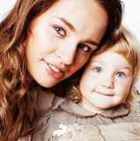 Young pretty stylish mother with little cute daughter hugging, h. Appy smiling family, lifestyle people concept close up Stock Photo