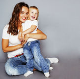 Young pretty stylish mother with little cute daughter hugging, h Stock Photography
