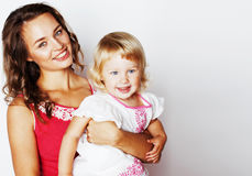 Young pretty stylish mother with little cute daughter hugging, h Royalty Free Stock Image