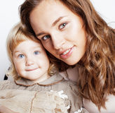 Young pretty stylish mother with little cute daughter hugging, happy smiling family, lifestyle people concept. Young pretty stylish mother with little cute blond Royalty Free Stock Image