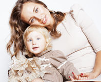 Young pretty stylish mother with little cute daughter hugging, happy smiling family, lifestyle people concept. Young pretty stylish mother with little cute blond Stock Image