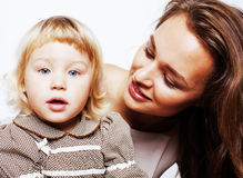 Young pretty stylish mother with little cute daughter hugging, happy smiling family, lifestyle people concept. Close up Royalty Free Stock Photography