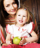 Young pretty stylish mother with little cute daughter hugging, happy smiling family, lifestyle people concept. Close up Royalty Free Stock Image