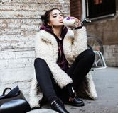 Young pretty stylish teenage girl outside on city street fancy f Stock Photos
