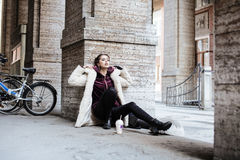 Young pretty stylish teenage girl outside on city street fancy f Royalty Free Stock Photography