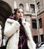 Young pretty stylish teenage girl outside on city street fancy f. Ashion dressed drinking milk shake, lifestyle concept Stock Photography