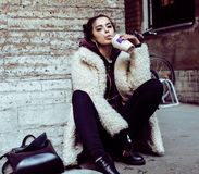 Young pretty stylish teenage girl outside on city street fancy f. Ashion dressed drinking milk shake, lifestyle concept Stock Photo