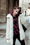 Young pretty stylish teenage girl outside on city street fancy fashion dressed drinking milk shake Stock Photos