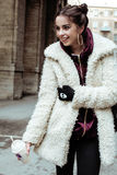 Young pretty stylish teenage girl outside on city street fancy fashion dressed drinking milk shake Stock Photography