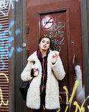 Young pretty stylish teenage girl outside at city wall with graf Stock Image
