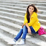 Young pretty stylish woman sitting on stairs Stock Image