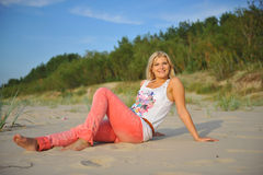 Young pretty summer woman relaxing on the beach Stock Images