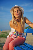 Young pretty summer woman relaxing on the beach Royalty Free Stock Image