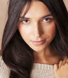 Young pretty tanned girl close up portrait smiling confident brunette warm. Lifestyle people concept Royalty Free Stock Photos