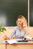 Young pretty teacher checking the tests. Stock Image