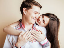 Young pretty teenage couple, hipster guy with his girlfriend hap Stock Photos