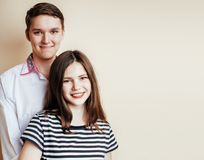Young pretty teenage couple, hipster guy with his girlfriend hap Royalty Free Stock Images
