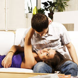 Young pretty teenage couple, hipster guy with his girlfriend happy smiling and hugging in home interior, lifestyle Royalty Free Stock Image