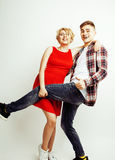 Young pretty teenage couple, hipster guy with his girlfriend happy smiling and hugging isolated on white background Stock Image