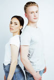Young pretty teenage couple, hipster guy with his girlfriend happy smiling and hugging isolated on white background Royalty Free Stock Image