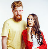 Young pretty teenage couple, hipster guy with his girlfriend happy smiling and hugging isolated on white background Royalty Free Stock Photography