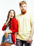 Young pretty teenage couple, hipster guy with his girlfriend happy smiling and hugging isolated on white background Stock Photos