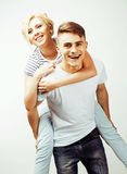 Young pretty teenage couple, hipster guy with his girlfriend happy smiling and hugging isolated on white background Stock Photography