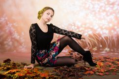 Young pretty teenage girl with autumn leaves Stock Images