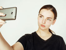 Young pretty teenage girl making selfie isolated on white background close up Stock Photos