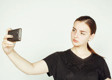 Young pretty teenage girl making selfie isolated on white background close up Royalty Free Stock Photography