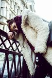 Young pretty teenage hipster girl outdoor in winter snow city ha Stock Photo
