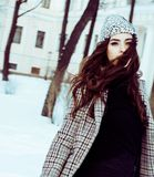 Young pretty teenage hipster girl outdoor in winter snow park ha Royalty Free Stock Photo