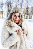Young pretty teenage hipster girl outdoor in winter snow park having fun drinking coffee, warming up happy smiling Stock Images