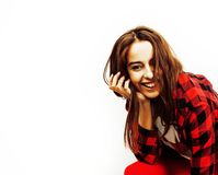 Young pretty teenage hipster girl posing emotional happy smiling on white background, lifestyle people concept close up royalty free stock images
