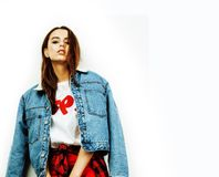 Young pretty teenage hipster girl posing emotional happy smiling on white background, lifestyle people concept royalty free stock photography