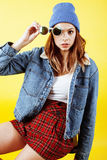 Young pretty teenage woman emotional posing on yellow background, fashion lifestyle people concept. Close up Stock Images