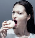 Young pretty thin girl with donut close up. Unhealthy habbit Stock Photography