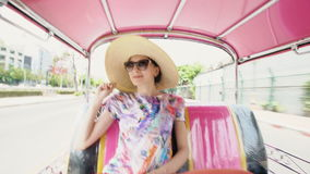 Young pretty tourist woman in hat ride on traditional thai bus songteo in Bangkok Thailand. Young pretty tourist woman in hat ride on traditional thai bus stock video