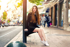 Young pretty trendy caucasian girl posing at the Europe city Royalty Free Stock Photography