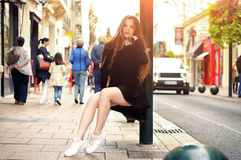 Young pretty trendy caucasian girl posing at the Europe city Royalty Free Stock Photos