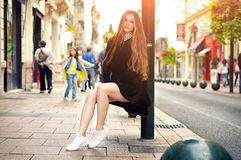 Young pretty trendy caucasian girl posing at the Europe city Royalty Free Stock Image