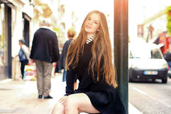 Young pretty trendy caucasian girl posing at the Europe city Stock Images