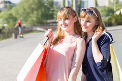 Young pretty twins girls looking aside Royalty Free Stock Images
